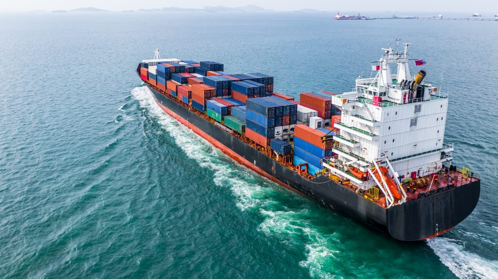 Aerial view cargo container ship sailing, container cargo ship in import export and business logistic and transportation of international by container ship in the open sea.
